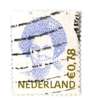 beatrix: NETHERLANDS - CIRCA 1991: An NETHERLANDS Used  Postage Stamp showing Portrait of Queen Beatrix of the Netherlands,Type Inversie, circa 1991.