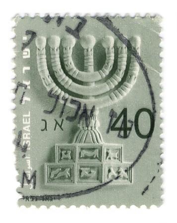 menora: ISRAEL- CIRCA 1990: A stamp printed in ISRAEL shows image of The Jewish Menora, circa 1990.