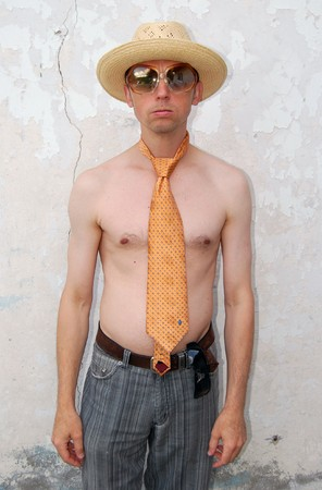 Nude man in a hat and tie. Stock Photo
