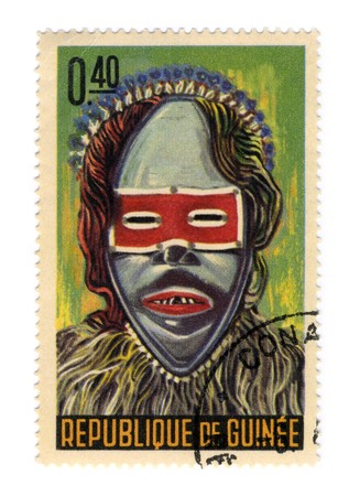 GUINEA - CIRCA 1965: A stamp printed in GUINEA shows Guinean masks circa 1965. Stock Photo - 7076865