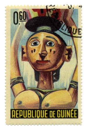 visard: GUINEA - CIRCA 1965: A stamp printed in GUINEA shows Guinean masks circa 1965. Editorial
