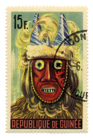 GUINEA - CIRCA 1965: A stamp printed in GUINEA shows Guinean masks circa 1965. Stock Photo - 7076894