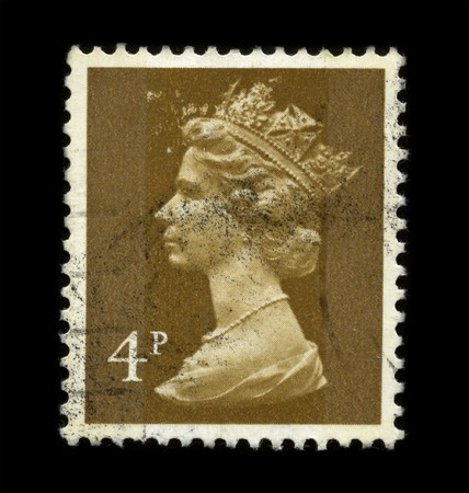 UNITED KINGDOM - CIRCA 1971: An English Used First Class Postage Stamp showing Portrait of Queen Elizabeth in brown circa 1971.