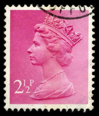 UNITED KINGDOM - CIRCA 1973: An English Used First Class Postage Stamp showing Portrait of Queen Elizabeth in pink circa 1973. Stock Photo - 7427926