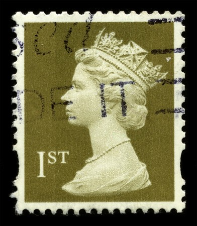 UNITED KINGDOM - CIRCA 1974: An English Used First Class Postage Stamp showing Portrait of Queen Elizabeth in light gold circa 1974. Stock Photo - 7427934