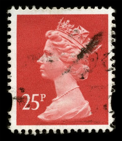 UNITED KINGDOM - CIRCA 1971: An English Used First Class Postage Stamp showing Portrait of Queen Elizabeth in red circa 1971.