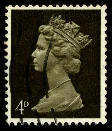 UNITED KINGDOM - CIRCA 1971: An English Used First Class Postage Stamp showing Portrait of Queen Elizabeth in dark gold circa 1971. Stock Photo - 7427937