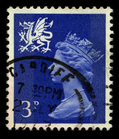 UNITED KINGDOM - CIRCA 1973: An English Used First Class Postage Stamp showing Portrait of Queen Elizabeth in dark blue circa 1973.