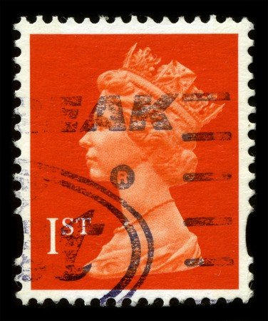 UNITED KINGDOM - CIRCA 1973: An English Used First Class Postage Stamp showing Portrait of Queen Elizabeth in red circa 1973.