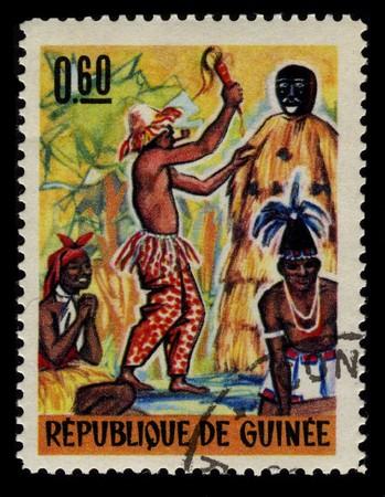 visard: GUINEA - CIRCA 1965: A stamp printed in GUINEA shows Guinean Voodoo Festival circa 1965.