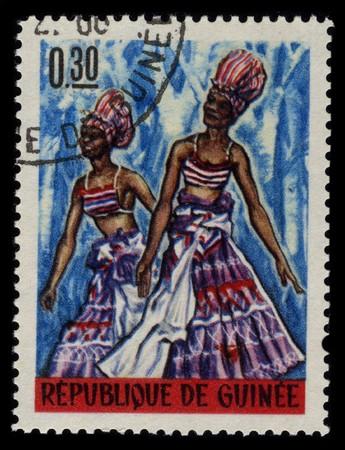 visard: GUINEA - CIRCA 1966: A stamp printed in GUINEA shows Guinean Voodoo Festival circa 1966.