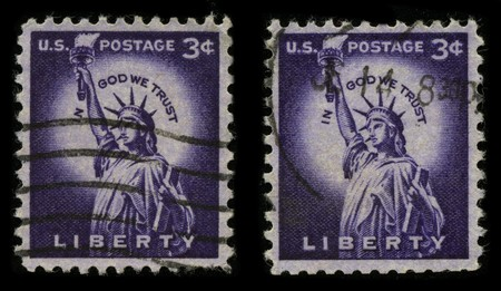 enlightening: USA - CIRCA 1930: Two stamp printed in USA shows image of the dedicated to The Statue of Liberty (Liberty Enlightening the World) circa 1930.