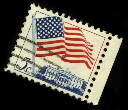 rotated: USA - CIRCA 1960: A stamp rotated forty-five degrees and  printed in USA shows image of the dedicated to the American Flag circa 1960.