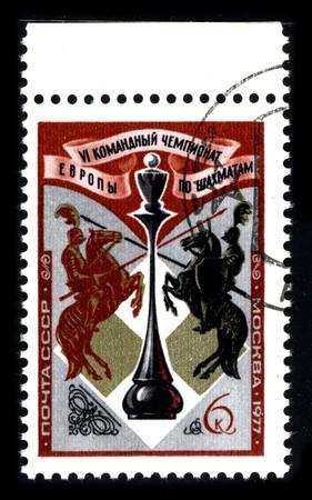 eligible: URSS - CIRCA 1977: Sello imprimido en espect�culos de USSR imagen de la dedicada para el Campeonato Europeo es un evento de ajedrez equipo internacional, derecho a la participaci�n de las Naciones europeas, cuyas federaciones de ajedrez se encuentran en zonas 1.1 a 1.9. Cir