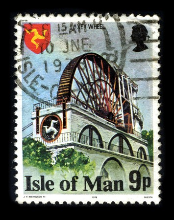 Isle Of Mann - CIRCA 1978: A stamp printed in Isle Of Mann shows image of the dedicated to The Laxey Wheel (also known as Lady Isabella) is a large waterwheel built in the village of Laxey in the Isle of Man circa 1978.