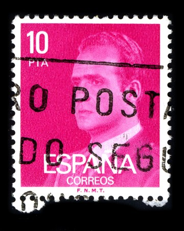 reigning: SPAIN - CIRCA 1980: A stamp printed in SPAIN shows image portrait Juan Carlos I (baptized as Juan Carlos Alfonso Victor Maria de Borbon y Borbon-Dos Sicilias; born in Rome, 5 January 1938) is the reigning King of Spain circa 1980.