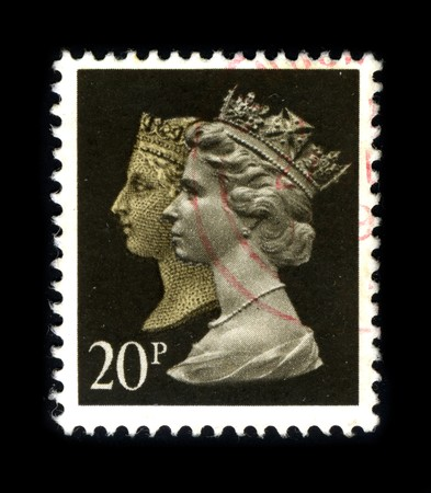 UNITED KINGDOM - CIRCA 1990: An English Used First Class Postage Stamp showing Two Portrait of Queen Elizabeth and Queen Victoria in gold circa 1990.