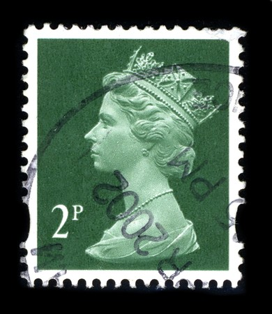 UNITED KINGDOM - CIRCA 2002: An English Used First Class Postage Stamp showing Portrait of Queen Elizabeth in green circa 2002. Stock Photo - 8150161