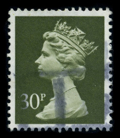UNITED KINGDOM - CIRCA 2002: An English Used First Class Postage Stamp showing Portrait of Queen Elizabeth in green circa 2002. Stock Photo - 8322644