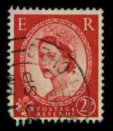 queen elizabeth: UNITED KINGDOM - CIRCA 1960: An English Used First Class Postage Stamp showing Portrait of Queen Elizabeth in red, circa 1960. Editorial