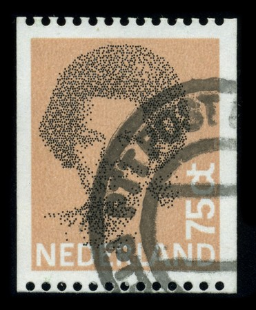 regnant: KINGDOM OF THE NETHERLANDS - CIRCA 1980: A stamp printed in KINGDOM OF THE NETHERLANDS shows image portrait Beatrix is the queen regnant of the Kingdom of the Netherlands comprising the Netherlands, Curacao, Sint Maarten, and Aruba, circa 1980. Editorial