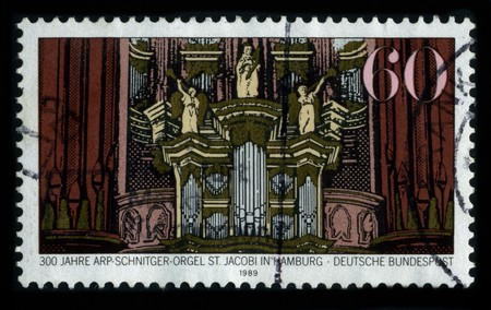 surviving: GERMANY-CIRCA 1989: A stamp dedicated to the Arp Schnitger organ in St. Jacobi Church, Hamburg, (St James Church), one of the five Hauptkirchen of Hamburg, is a world-famous monument of North-German organ building, and the largest surviving baroque organ