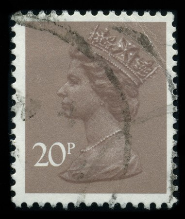 UNITED KINGDOM - CIRCA 1980: An English Used First Class Postage Stamp showing Portrait of Queen Elizabeth in brown, circa 1980. Stock Photo - 8322688