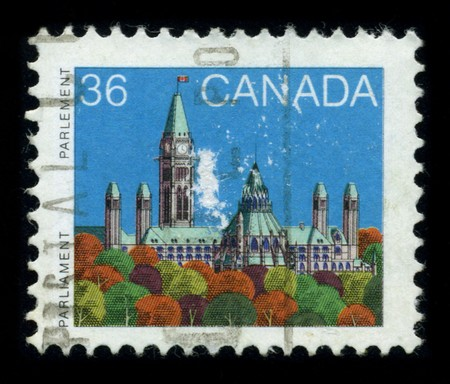 CANADA - CIRCA 1980: A stamp shows image of the dedicated to The Parliament of Canada (French: Parlement du Canada) is the federal legislative branch of Canada, seated at Parliament Hill in the national capital, Ottawa, circa 1980. Stock Photo - 8322686