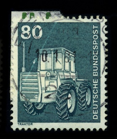 high torque: GERMANY - CIRCA 1981: A stamp of the dedicated to the Tractor is a vehicle specifically designed to deliver a high tractive effort (or torque) at slow speeds, for the purposes of hauling a trailer or machinery used in agriculture or construction, circa 19
