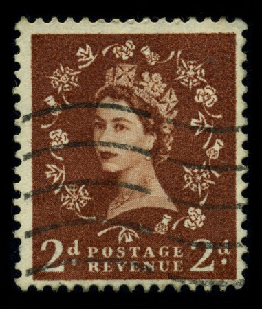 UNITED KINGDOM - CIRCA 1960: An English Used First Class Postage Stamp showing Portrait of Queen Elizabeth in red, circa 1960.