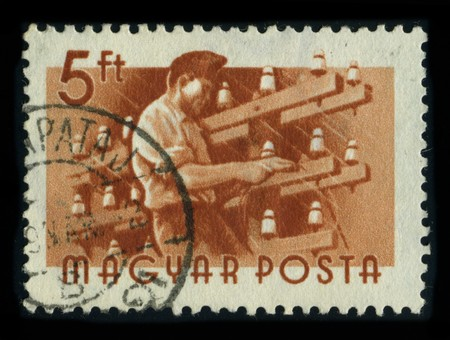 GUNGARY - CIRCA 1980: A stamp dedicated to the An electrician is a tradesman specializing in electrical wiring of buildings, stationary machines and related equipment, circa 1980.