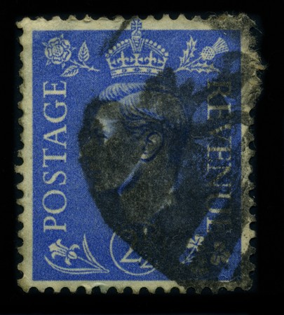 dominions: UNITED KINGDOM - CIRCA 1937: A stamp shows image portrait George VI (Albert Frederick Arthur George; 14 December 1895 - 6 February 1952) was King of the United Kingdom and the British Dominions from 11 December 1936 until his death, circa 1937. Editorial