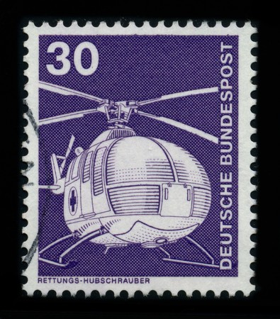 thrust: GERMANY - CIRCA 1980: A stamp shows image of the dedicated to the Helicopter is a type of rotorcraft in which lift and thrust are supplied by one or more engine driven rotors, circa 1980. Editorial