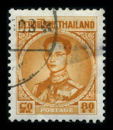 THAILAND - CIRCA 1950: A stamp printed in USA shows image portrait Bhumibol Adulyadej (Royal Institute: Phumiphon Adunyadet born 5 December 1927) is the current King of Thailand, circa 1950. Stock Photo - 8161085