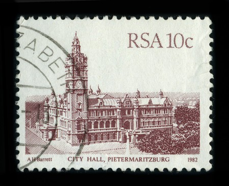 redbrick: SOUTH AFRICA - CIRCA 1982: A stamp shows image of the dedicated to the Pietermaritzburg City Hall, constructed in 1893, destroyed by fire in 1895, rebuilt in 1901; the largest red-brick building in the Southern Hemisphere, circa 1982.