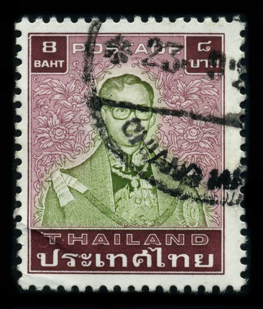 THAILAND - CIRCA 1970: A stamp printed in USA shows image portrait Bhumibol Adulyadej (Royal Institute: Phumiphon Adunyadet born 5 December 1927) is the current King of Thailand, circa 1970. Stock Photo - 8161111
