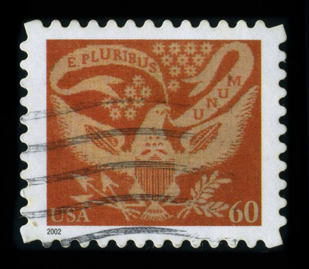 pluribus: USA-CIRCA 2002: A stamp dedicated to the E pluribus unum, Latin for Out of many, one, is a motto on the Seal of the United States, along with Annuit c?ptis and Novus ordo seclorum, and adopted by an Act of Congress in 1782, circa 2002.