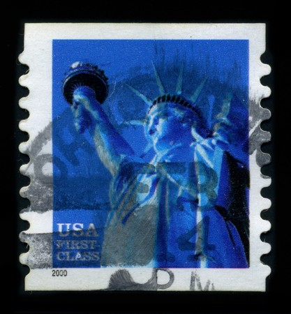 postal office: USA-CIRCA 2000: A stamp dedicated to the The Statue of Liberty (Liberty Enlightening the World [French: La Liberte eclairant le monde]) is a colossal neoclassical sculpture on Liberty Island in New York Harbor, designed by Frederic Bartholdi and dedicated Editorial