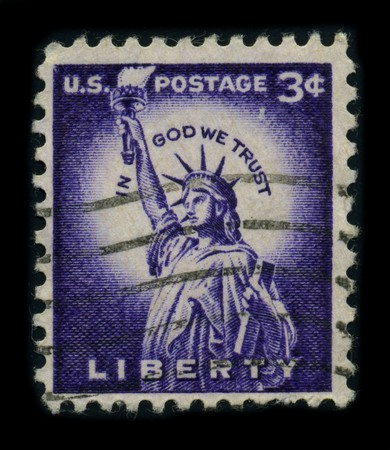 enlightening: USA-CIRCA 1954: A stamp dedicated to the The Statue of Liberty (Liberty Enlightening the World [French: La Liberte eclairant le monde]) is a colossal neoclassical sculpture on Liberty Island in New York Harbor, designed by Frederic Bartholdi and dedicated