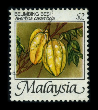 MALAYSIA-CIRCA 1980: A stamp of the dedicated to the Averrhoa carambola is a species of woody plant in the family Oxalidaceae; it has a number of common names including Carambola and Starfruit, circa 1980. Stock Photo - 8194299
