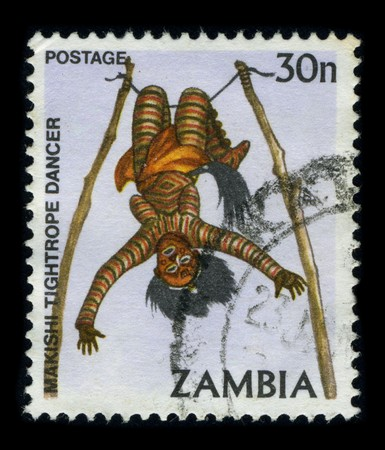 ZAMBIA-CIRCA 1980: A stamp dedicated to The Zambian Makishi Festival (In Zambia the Luvale people hold the Makishi festival to mark the end of the kumukanda (or initiation), circa 1980.