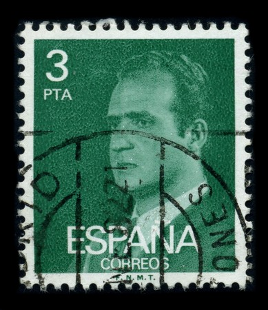 reigning: SPAIN - CIRCA 1990: A stamp printed in SPAIN shows image portrait Juan Carlos I (baptized as Juan Carlos Alfonso Victor Maria de Borbon y Borbon-Dos Sicilias; born in Rome, 5 January 1938) is the reigning King of Spain circa 1990.