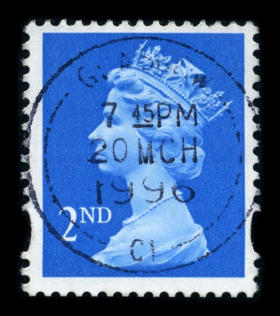 UNITED KINGDOM - CIRCA 1996: An English Used First Class Postage Stamp showing Portrait of Queen Elizabeth in blue, circa 1996.