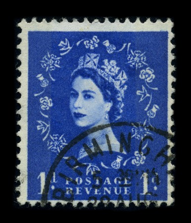 UNITED KINGDOM - CIRCA 1960: An English Used First Class Postage Stamp showing Portrait of Queen Elizabeth in blue, circa 1960.