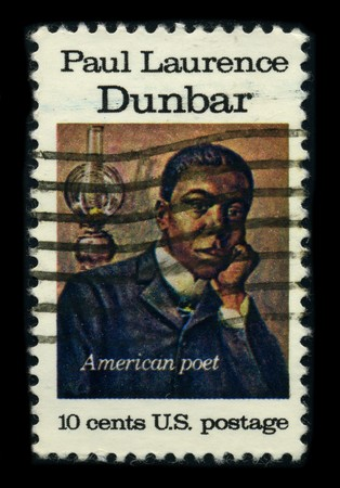 seminal: USA - CIRCA 1975: A stamp shows image portrait Paul Laurence Dunbar (June 27, 1872 - February 9, 1906) was a seminal African American poet of the late 19th and early 20th centuries, circa 1975. Editorial