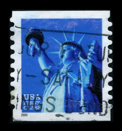 enlightening: USA-CIRCA 2000: A stamp dedicated to the The Statue of Liberty (Liberty Enlightening the World [French: La Liberte eclairant le monde]) is a colossal neoclassical sculpture on Liberty Island in New York Harbor, designed by Frederic Bartholdi and dedicated Editorial