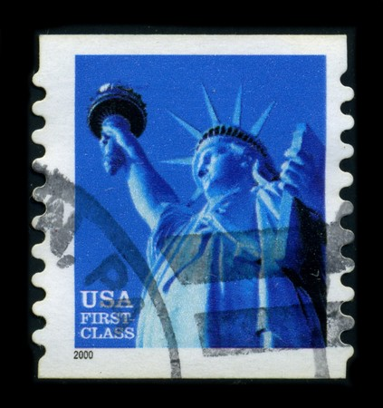 frederic: USA-CIRCA 2000: A stamp dedicated to the The Statue of Liberty (Liberty Enlightening the World [French: La Liberte eclairant le monde]) is a colossal neoclassical sculpture on Liberty Island in New York Harbor, designed by Frederic Bartholdi and dedicated Editorial