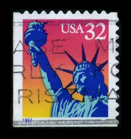 postal office: USA-CIRCA 1997: A stamp dedicated to the The Statue of Liberty (Liberty Enlightening the World [French: La Liberte eclairant le monde]) is a colossal neoclassical sculpture on Liberty Island in New York Harbor, designed by Frederic Bartholdi and dedicated Editorial
