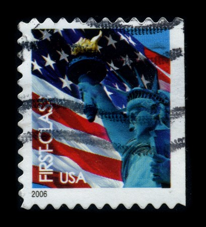 enlightening: USA-CIRCA 2006: A stamp dedicated to the The Statue of Liberty (Liberty Enlightening the World [French: La Liberte eclairant le monde]) is a colossal neoclassical sculpture on Liberty Island in New York Harbor, designed by Frederic Bartholdi and dedicated