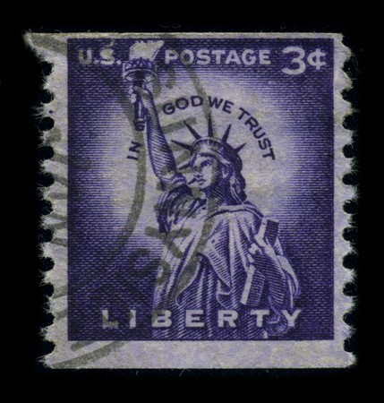USA-CIRCA 1954: A stamp dedicated to the The Statue of Liberty (Liberty Enlightening the World [French: La Liberte eclairant le monde]) is a colossal neoclassical sculpture on Liberty Island in New York Harbor, designed by Frederic Bartholdi and dedicated